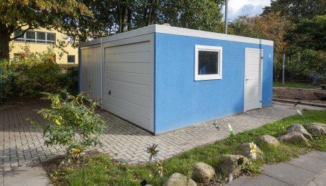 Doppelgarage als Materialhaus in blau für Kindergarten